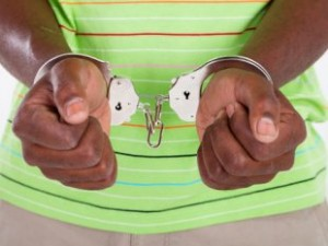 Black teen handcuffed