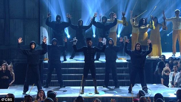 Pharrell Williams hands up